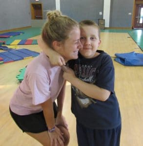 James and a counselor in the gym at Camp Royall, an autism summer camp